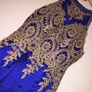 Deep blue long mermaid gown.
